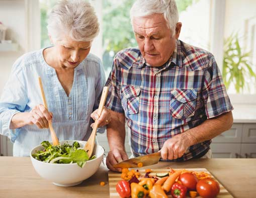 senior-couple-preparing-saladjpg